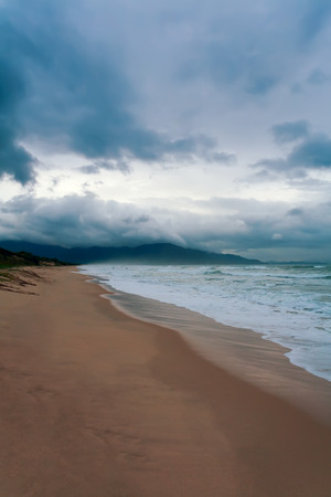 the sea coast with clouds in a thunder-storm photo