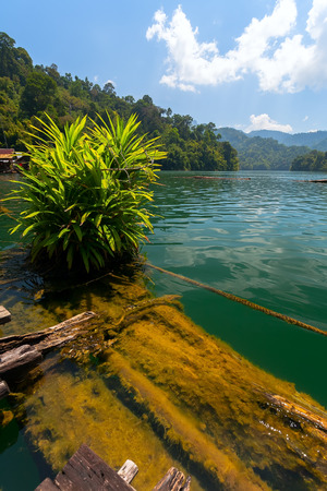 Floating village on Lake Cheo lan in Thailand photo