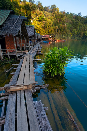 Traditional Thai bamboo bungalows floating at the Cheow Lan Lake, Khao Sok National Park, Thailand photo