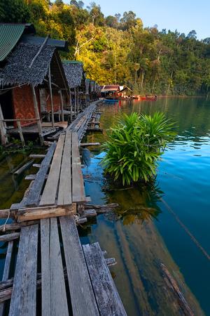 sok: Traditional Thai bamboo bungalows floating at the Cheow Lan Lake, Khao Sok National Park, Thailand