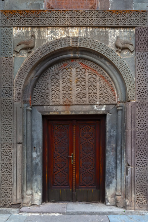 wood carving door: Carved wooden doors and stone wall of Tufa
