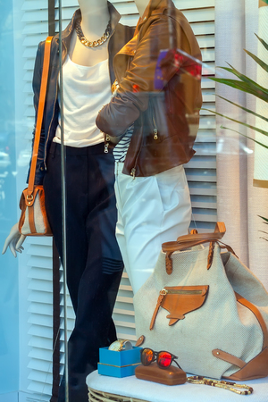 window display: Window display with mannequins and accessories. Stock Photo