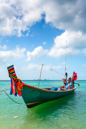 water's: Wooden fishing boat near the sandy sea shore in the turquoise waters.