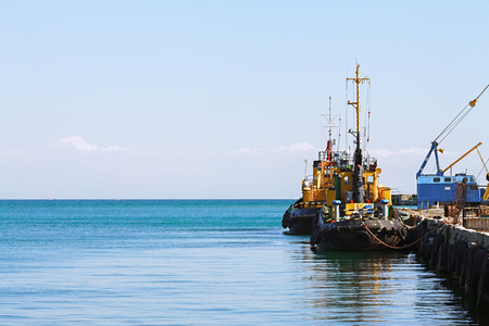 The ship tow of yellow color in seaport. Russia Stock Photo