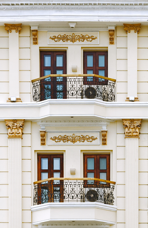 balcony window: Close up of classic style building focus on balcony, column, baluster and window detail.