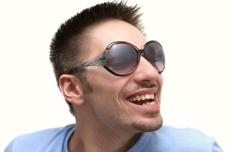 ridiculous and cheerful guy smiles, isolated background photo