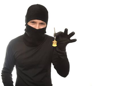 thievery: thief with flat keys on the isolated background Stock Photo