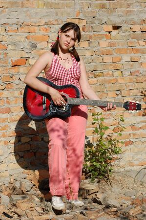 teenager girl with red guitar Stock Photo - 3159740