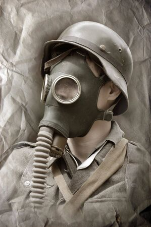 German soldier in gas mask . WW2 reenacting photo