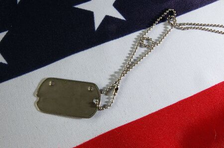 Dog tag on American Flag.Freedom is not free Stock Photo - 7515787
