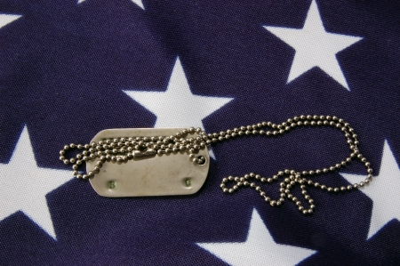 Dog tag on American Flag.Freedom is not free Stock Photo - 7515789