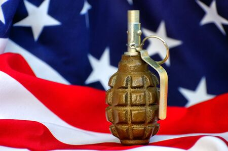 Hand grenade and and USA flag  photo