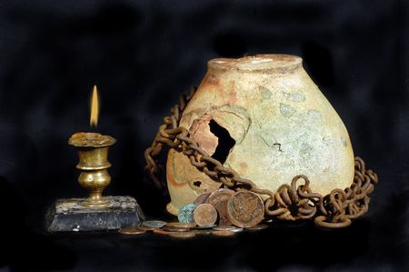 Ancient jug with coins photo