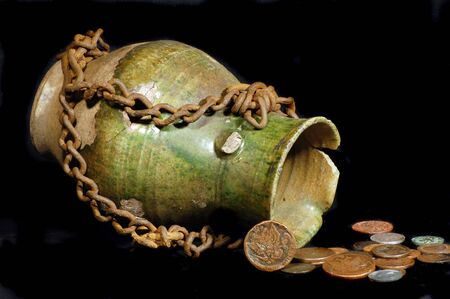 Ancient jug with coins