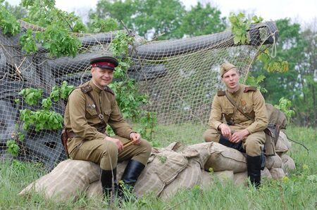 KIEV, UKRAINE - MAY 10 : Members of Red Star history club wear historical Soviet uniform during historical reenactment of 1945 WWII, May 10, 2010 in Kiev, Ukraine
