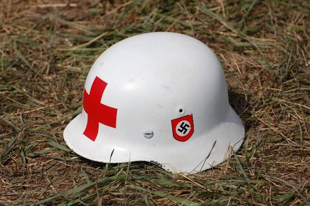 KIEV, UKRAINE - MAY 10,2010 : German military paramedic helmet during historical reenactment of 1945 WWII, May 10, 2010 in Kiev, Ukraine.