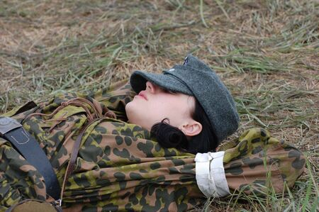 KIEV, UKRAINE - MAY 10,2010 : member of Red Star history club wears historical military German paramedic uniform during historical reenactment of 1945 WWII, May 10, 2010 in Kiev, Ukraine