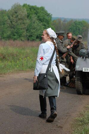 KIEV, UKRAINE - MAY 10,2010 : member of Red Star history club wears historical military German paramedic uniform during historical reenactment of 1945 WWII, May 10, 2010 in Kiev, Ukraine