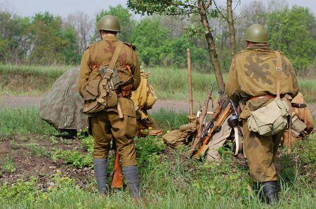 KIEV, UKRAINE - MAY 10 : Members of Red Star history club wear historical Soviet uniform during historical reenactment of 1945 WWII, May 10, 2010 in Kiev, Ukraine  Stock Photo - 7551300