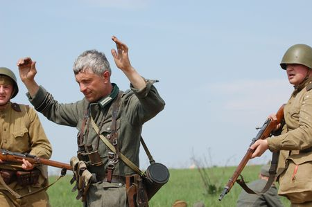 prisoner of war: KIEV, UKRAINE - MAY 10 : Members of Red Star history club wear historical German&Soviet uniform during historical reenactment of 1945 WWII, May 10, 2010 in Kiev, Ukraine