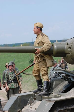 KIEV, UKRAINE - MAY 10 : A member of Red Star history club wears historical Soviet uniform during historical reenactment of 1945 WWII, May 10, 2010 in Kiev, Ukraine