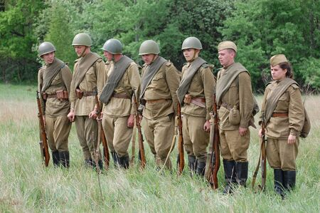 soviet: KIEV, UKRAINE - MAY 10 : Members of Red Star history club wear historical Soviet uniform during historical reenactment of 1945 WWII, May 10, 2010 in Kiev, Ukraine  Editorial