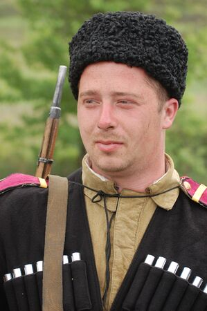 KIEV, UKRAINE - MAY 10 : A member of Red Star history club wears historical Soviet uniform during historical reenactment of 1945 WWII, May 10, 2010 in Kiev, Ukraine  Stock Photo - 7551366