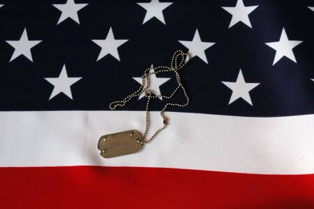 Dog tag on American Flag.Freedom is not free  photo
