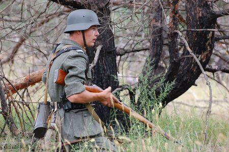CHERNIGOW, UKRAINE - AUG 29: A member of Red Star military history club wears historical German uniform during historical reenactment of WWII, August 29, 2010 in Chernigow, Ukraine