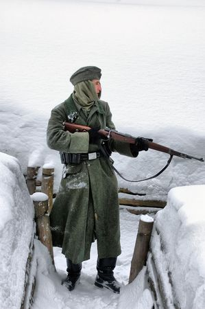 KIEV, UKRAINE - FEB 14: Members of a history club wear historical German uniforms during a WWII reenactment of Defense Kiev in 1943. The event took place on February 14, 2010 in Kiev, Ukraine.
