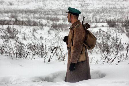 KIEV, UKRAINE - FEB 14: Members of a history club wears historical Soviet uniforms in action during a WWII reenactment of Defense Kiev in 1943 on February 14, 2010 in Kiev, Ukraine.