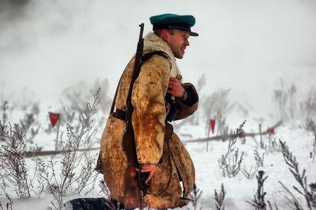 reenaction: KIEV, UKRAINE - FEB 14: Members of a history club wears historical Soviet uniforms in action during a WWII reenactment of Defense Kiev in 1943 on February 14, 2010 in Kiev, Ukraine.