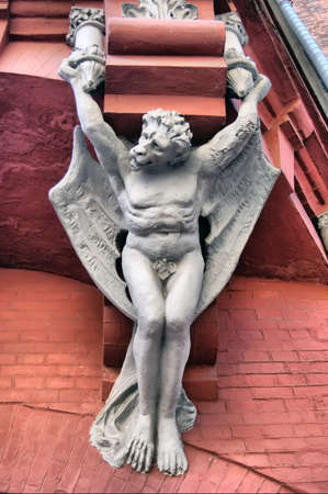 HDR.Architecture demon with wings on wall of house in Kiev, Ukraine Stock Photo - 7713849