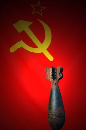 Soviet Flag &amp, 82 mm mortar shell photo