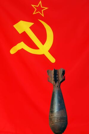 Soviet Flag & 82 mm mortar shell photo