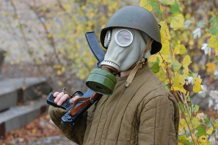 environmental safety: person in gas mask