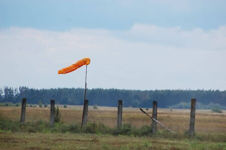orange weather vane  photo