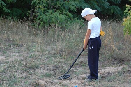 KIEV, UKRAINE - SEP 11: unidentified Member Ukrainian Federation Metal Searchin Sport on the First Ukrainian Competition of Treasure Hunting, Kids competition,September 11, 2010 in Kiev, Ukraine  Stock Photo - 7738977