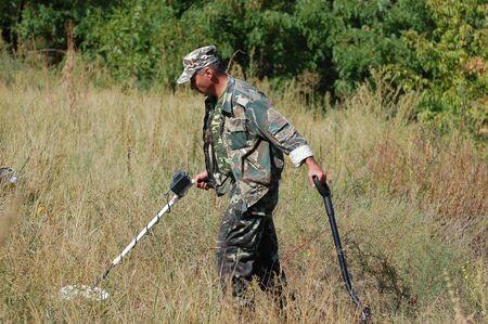KIEV, UKRAINE - SEP 11: Member of Ukrainian Federation of Metal Searchin Sport on the First Ukrainian Competition of Treasure Hunting, September 11, 2010 in Kiev, Ukraine  Stock Photo - 7738988