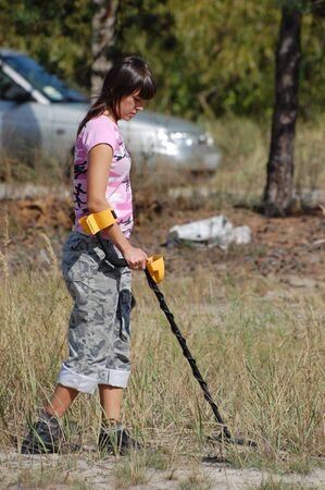 scavenging: KIEV, UKRAINE - SEP 11: Member of Ukrainian Federation of Metal Searchin Sport on the First Ukrainian Competition of Treasure Hunting, September 11, 2010 in Kiev, Ukraine