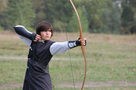 weaponry: KIEV, UKRAINE - SEP 19: Participant of Festivale of medieval costume wears historical costume September 19, 2010 in Kiev, Ukraine