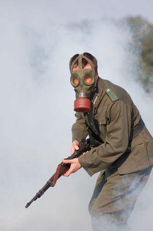 German soldier in gas mask. WW2 reenacting Stock Photo - 7810373
