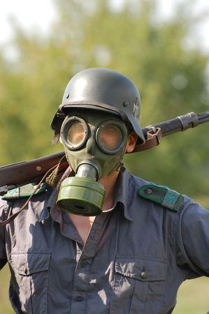 German soldier in gas mask. WW2 reenacting Stock Photo - 7810380