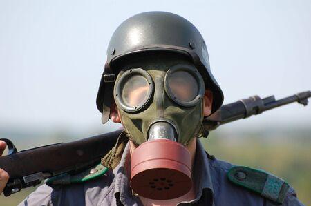 German soldier in gas mask. WW2 reenacting  photo