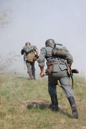 military invasion: German soldiers.WW2 historical reenactment Stock Photo