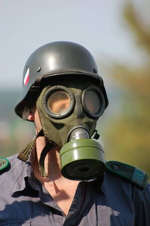 German soldier in gas mask. WW2 reenacting  photo