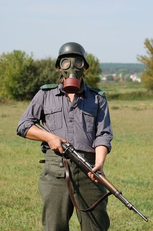 German soldier in gas mask  photo