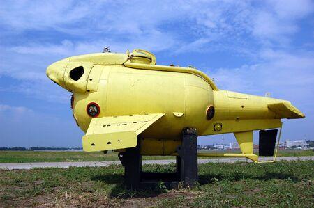 Submarine yellow .Old underwater diving equipment. Soviet. Exposition on gasoline station in Odessa region. Ukraine Stock Photo - 7811912