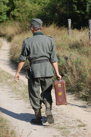 road warrior: German soldier of WW2 with suitcase
