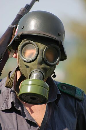 German soldier in gas mask.WW2 historical reenactment Stock Photo - 7906236